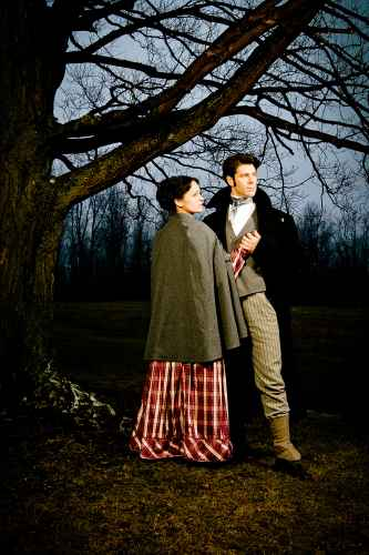 couple in period clothing under tree